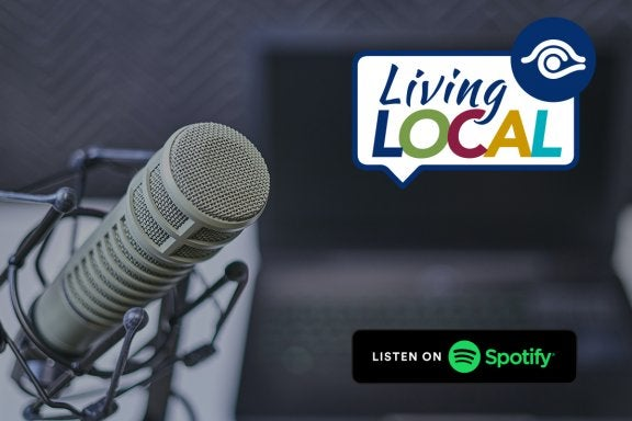 photo of microphone with living local logo and listen on spotify logo