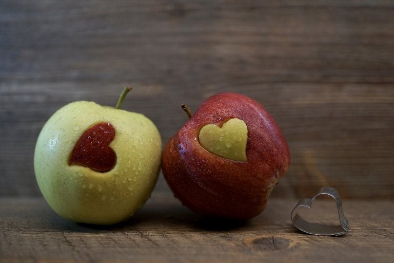 photo of green apple with red apple heart and red apple with green apple heart